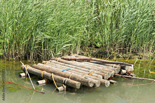 Wooden raft in the water - 69280582