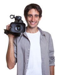Lachender Kameramann hat Spass am Filmen