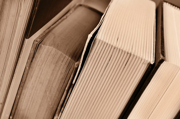 books, in sepia tone