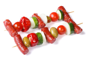grilled sausages with vegetables on skewers isolated