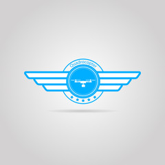 Blue vector sign of quadrocopter with wings