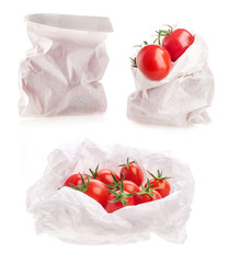 Collections of Tomatoes in white paper bag isolated on white bac
