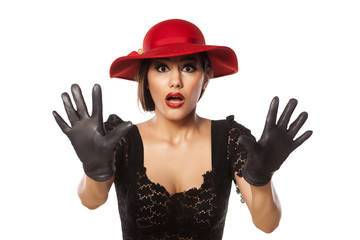 frightened woman with red hat and leather gloves