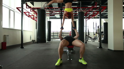 Pair of acrobats training in gym