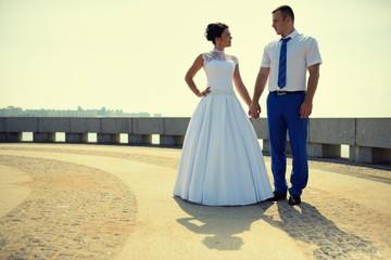 Couple of newlyweds on the embankment