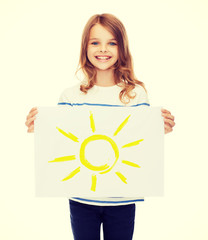 smiling little child holding picture of sun