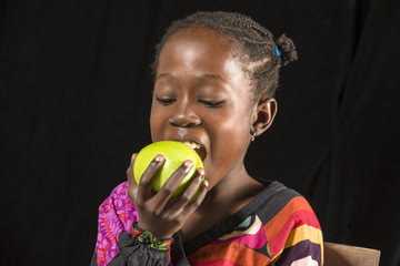 African girl eating fruit