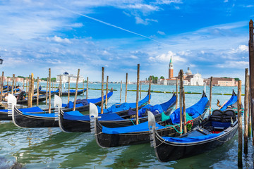 Gondolas moored by San Marco square, Venice
