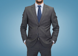 close up of businessman over blue background