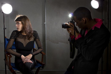 photographer taking an actress photo with flash strobes