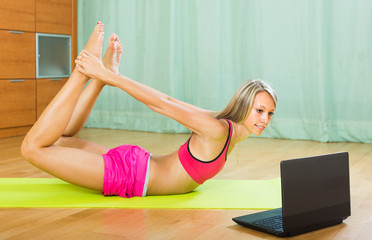 Woman having pilates with notebook