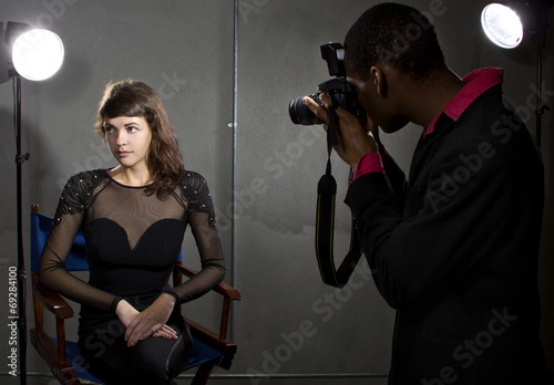 photographer taking an actress photo with flash strobes Poster