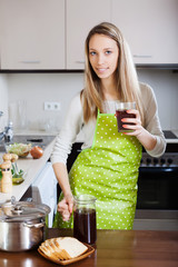 woman in apron with fresh quass