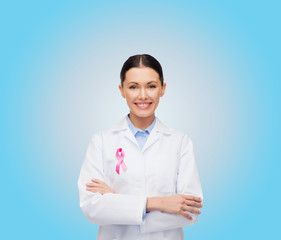 smiling female doctor with cancer awareness ribbon