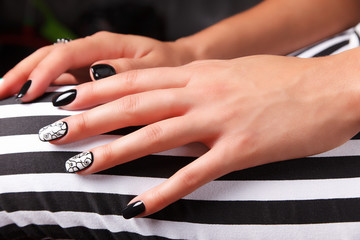Portrait of beautiful nail art of manicured and painted fashion