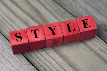 style word on red wooden cubes