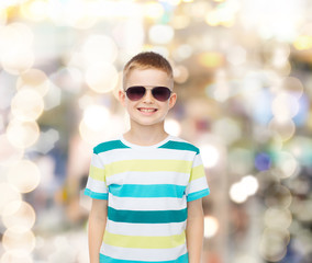 smiling cute little boy in sunglasses