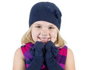 girl wearing a winter hat scarf and mittens