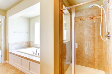 Bathroom in soft ivory with glass door shower