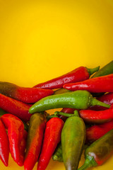 Hot Peppers on the Yellow Background