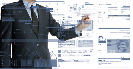 businessman drawing different graphs and charts
