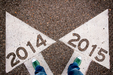 white arrows with 2014 and 2015 sign
