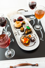 Tasting of wine and pattie chocolate pastries at the chocolate.