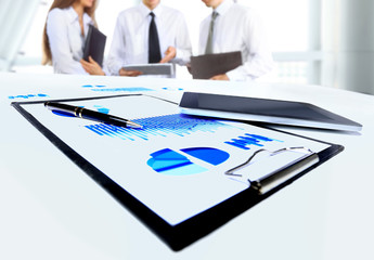 business document in touchpad lying on the desk