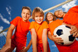 Four happy kids with football portrait - 69288539
