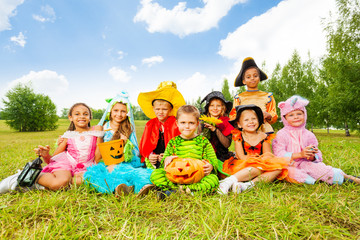 Smiling children in Halloween costumes together