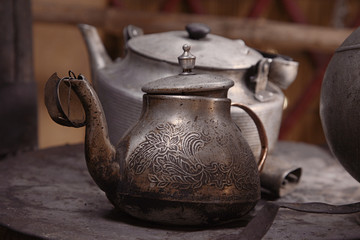 old teapot and kettle in a kyrgyz yurt kitchen, shallow dof