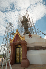 Buddha statue under construction at Wat Kroen Kathin, Thailand