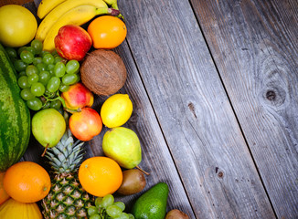 Huge group of fresh colorful fruit on wooden background - High q