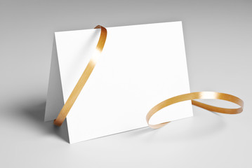 Blank card with golden ribbon