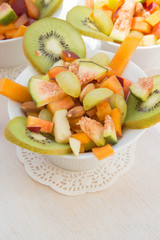 Fruit salad in the white plate