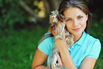 Young cute girl with puppy, yorkshire terrier