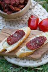 Pieces of french bread with dried tomatoes,oilve oil,and oregan