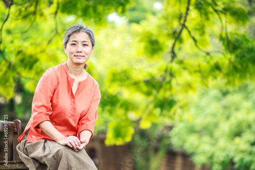 canvas print picture Portrait of serene mature woman in garden