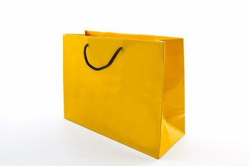 Blank yellow paper shopping bag.
