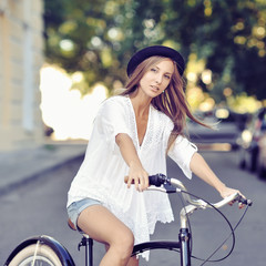 Girl on a vintage bike
