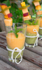 Three glasses of smoothie melon-kiwi