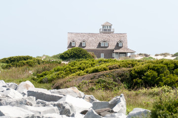 The restored Oregon Inlet Life Saving Station stands on the Nort