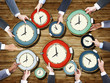 Group of Business People's Hands Holding Clocks