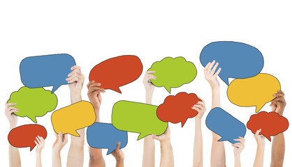 Multiethnic Group of Hands Holding Speech Bubbles