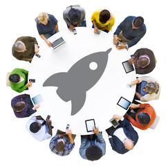 Diverse People Using Digital Devices with Rocket Symbol