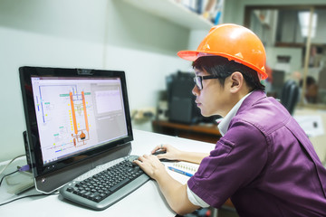Engineer student looking simulated oil distillation in computer