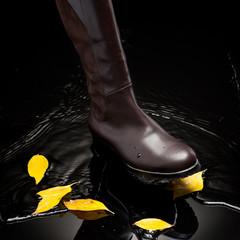 brown female boot splashing water