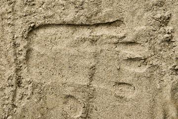 Handprint on the sand