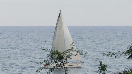 sailboat navigating at sunset in mediterranean sea