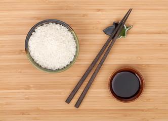 Rice bowl, chopsticks and soy sauce